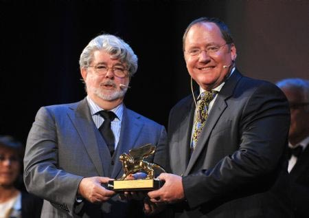 George Lucas presenting John Lasseter with the Golden Lion