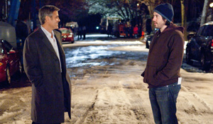 (from left) George Clooney and Jason Reitman on the set of Up in the Air
