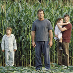 (from left) Rory Culkin, Mel Gibson, Abigail Breslin and Joaquin Phoenix in Signs