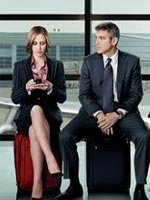 Vera Farmiga and George Clooney in Up in the Air