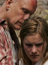 John Malkovich and Jessica Haines in Disgrace