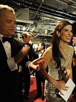 (from left) Tom Hanks and Sandra Bullock backstage at the 82nd annual Academy Awards